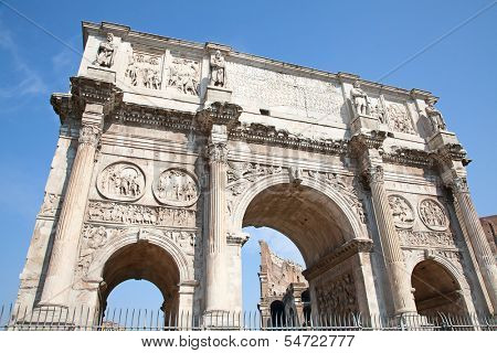 Arch of Constantine and coliseum in background. Rome, Italy