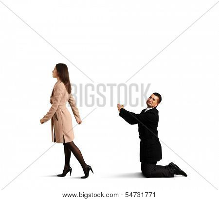 sad man bending the knee before outgoing woman. isolated on white background