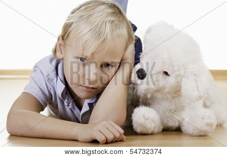 Blond Boy With White Toy Dog