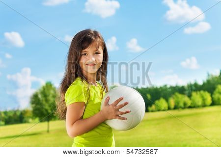 Happy Girl With Long Hair And Ball