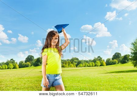 Little Child With Paper Plane