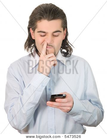 Young Handsome Guy Picks His Nose And Holds Cell Phone Isolated White
