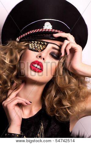 Fashion woman with bandage on an eye. Fashion pirate portrait