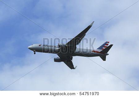 American Airlines Boeing 767 in New York sky before landing at JFK Airport