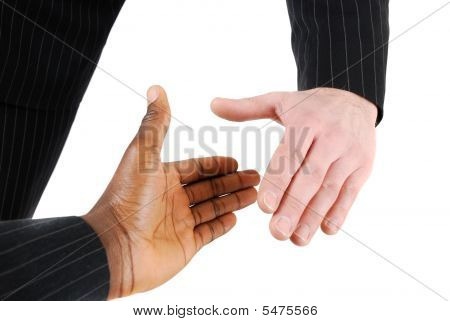 Multiracial Handshake Between Two Business Men