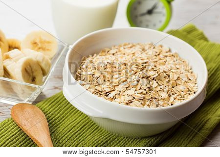 Oat Flakes In Bowl With Banana And Milk