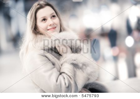 Young Woman In Winter Clothing Indoors Portrait