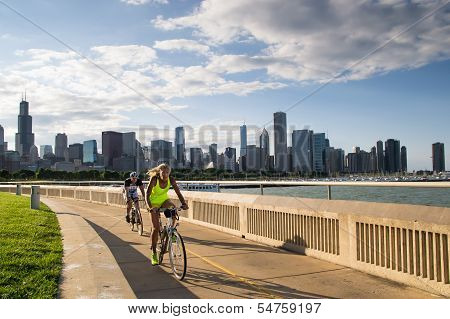 Cyclists In Chicago During Sunset