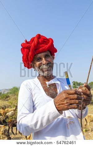 A Rajasthani Tribal Man Wearing Traditional Colorful Turban And Loves To Pose