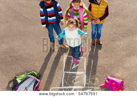 Friends Play Hopscotch