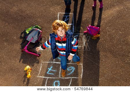 Boy Jumping On Hopscotch Game