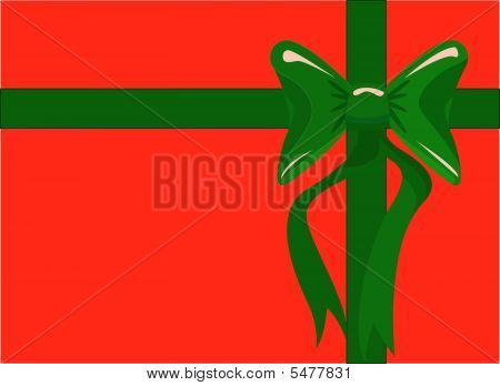 Red Christmas Box With A Green Bow And Ribbon