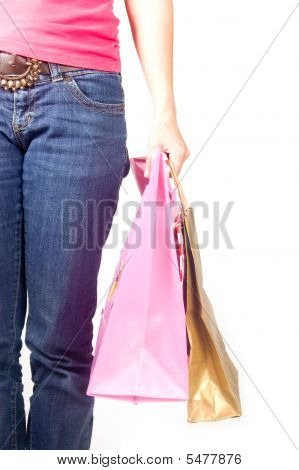 Image Of Female Holding Shoppingbags In Her Hand