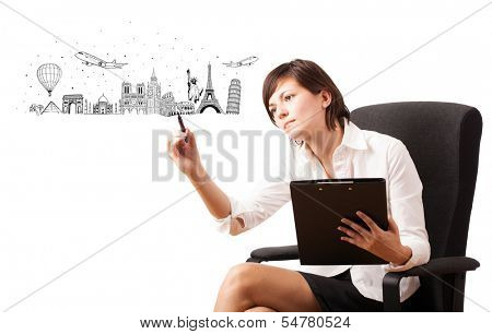 Young woman drawing famous cities and landmarks on whiteboard isolated on white