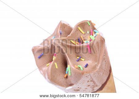 Chocolate ice cream cone. Sprinkles.
