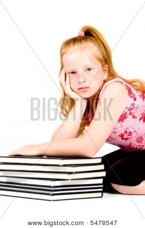 Girl Is Tired After Reading A Stack Of Books