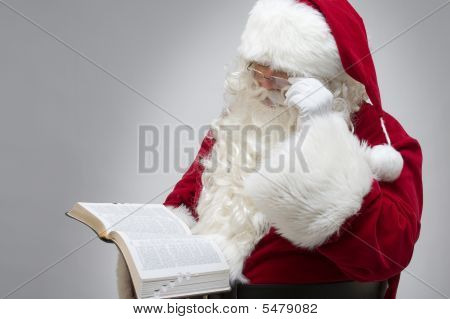 Santa Reading The Bible