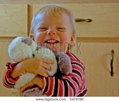 Toddler Hugging Stuffed Toy