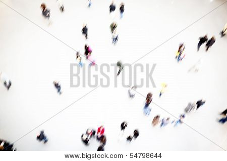People moving around in a hall, blurry