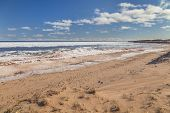 Cavendish beach on the north shore of Prince Edward Island during late winter. poster
