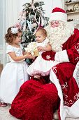 picture of saint-nicolas  - Saint Nicolas gives to small children Christmas gifts - JPG