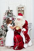 image of saint-nicolas  - Saint Nicolas gives Christmas gifts to the little girl - JPG
