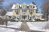image of suburban city  - Majestic Newly Constructed Home Facade with Giant Christmas Wreaths on a Snowing Blustery Day - JPG