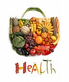 picture of harvest  - healthy food symbol represented by foods in the shape of a heart to show the health concept of eating well with fruits and vegetables - JPG
