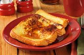 stock photo of french toast  - Buttery french toast with syrup from thick Texas toast
