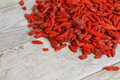 image of tibetan  - Tibetan goji berries on a wooden table top view - JPG