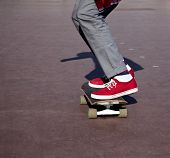 picture of skateboard  - Skateboarder legs before jumping on the outdoors - JPG