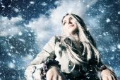 pic of blonde woman  - Young blond woman in a blizzard - JPG