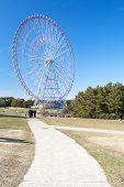 stock photo of pubic  - Ferris wheel in blue sky from pubic park - JPG