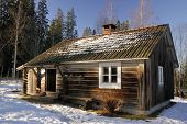stock photo of nordic skiing  - Traditional log cabin in a holiday resort in Dalarna - JPG