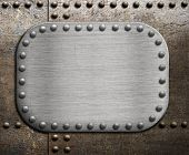 stock photo of ironclad  - Rough metallic plate over rusty metal background - JPG