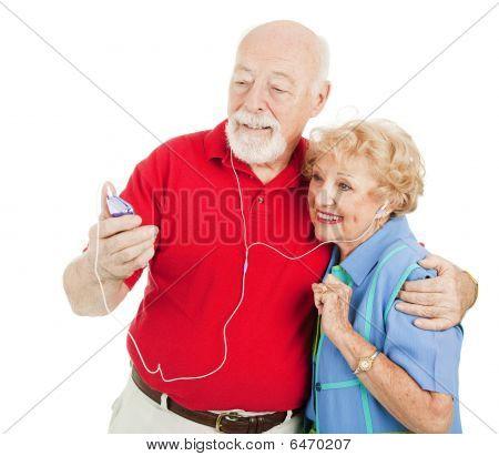 Senior Couple Listening To Mp3S