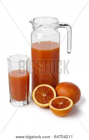 Fresh blood orange juice in a jar on white background