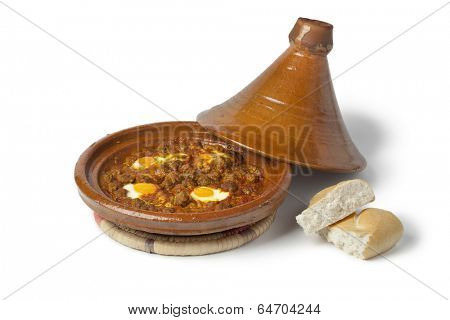 Moroccan kefta tagine with eggs (Mkaouara) on white background