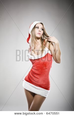 Studio Portrait Of A Sexy Young Dressed As Santa