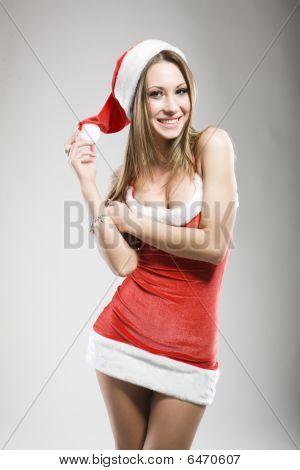 Studio Portrait Of Sexy Smiling Woman Dressed As Santa