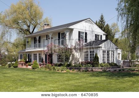 White Home With Second Floor Balcony