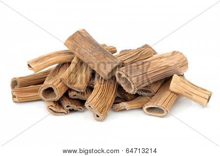 Reed root herb chinese herbal medicine over white background. Lu gen. Phragmites.
