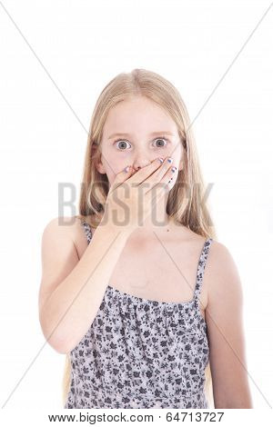 Young Blond Girl With Hand On Mouth In Studio