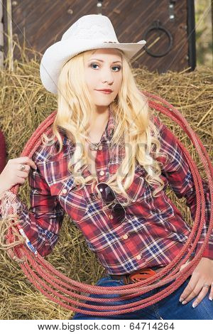 Portrait Of Sensual Caucasian Cowgirl With Lasso Rope In Farm