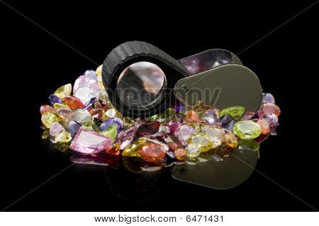 Colorful Gems And Loupe