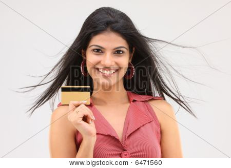 cute girl holding credit card
