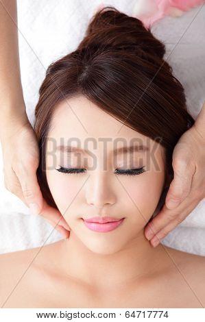 Woman Enjoy Receiving Face Massage At Spa