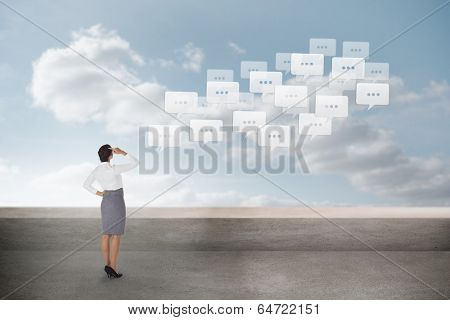 Businesswoman scratching her head against balcony and cloudy sky