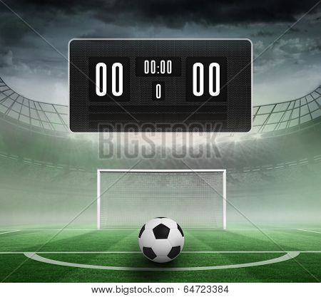 Black scoreboard with no score and football against football pitch in large stadium