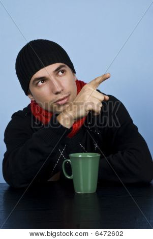 Young Man With Cap Pointing Up